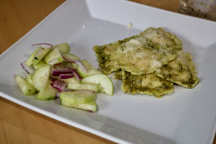 Cucumber salad (cucumber, onion, rice vinegar) and gluten free sweet potato ravioli with pesto and parmesan. Yum! (I had a little bit more after this plate.)