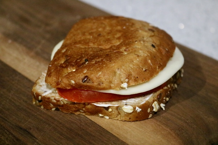 I had a small sandwich with mayo, tomato, and a slice of provolone on multigrain bread. This was super yummy and easy.