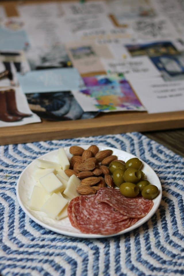 While vision boarding I snacked on this cheese plate: salami, white cheddar goat cheese, almonds, and green olives (soooo good).
