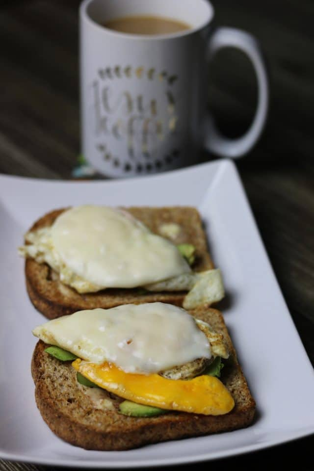 I made breakfast: two slices of toasted Ezekiel with avocado slices and one egg on top of each (plus coffee with milk and stevia).