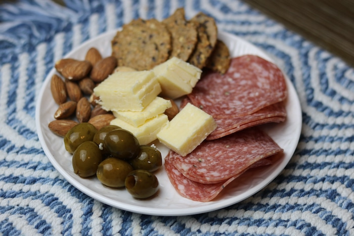 On my snack plate: green olives, roasted almonds, cheese (Kerrygold brand), salami, and Mary's crackers. So yummy!