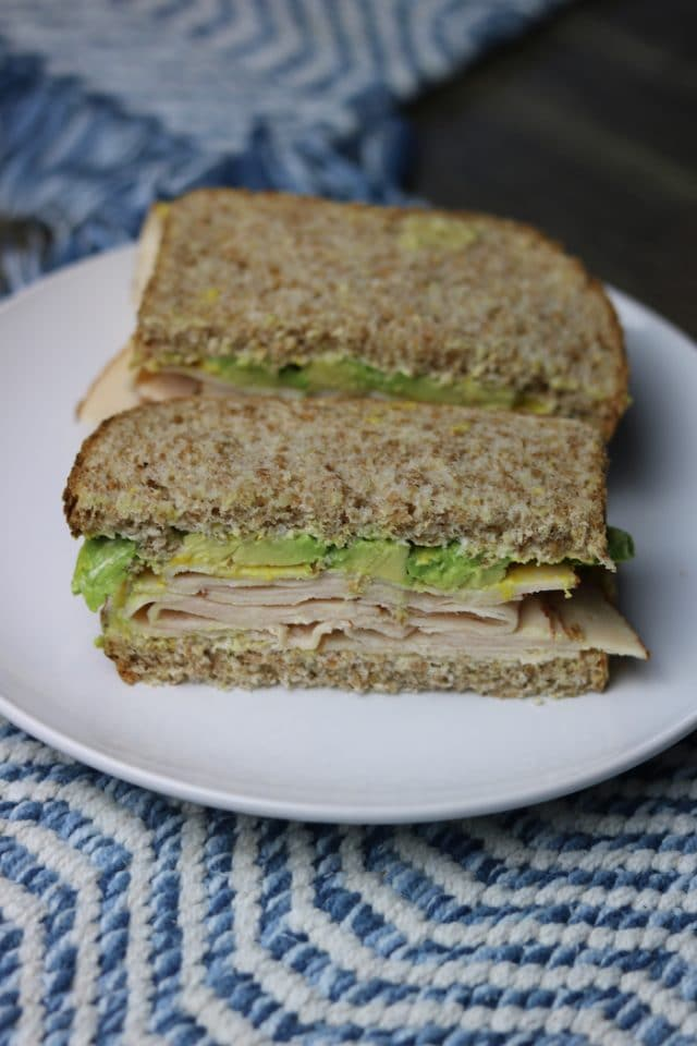 When I got home from the gym I made a quick sandwich with sliced deli chicken, avocado, mayo and mustard on Ezekiel.