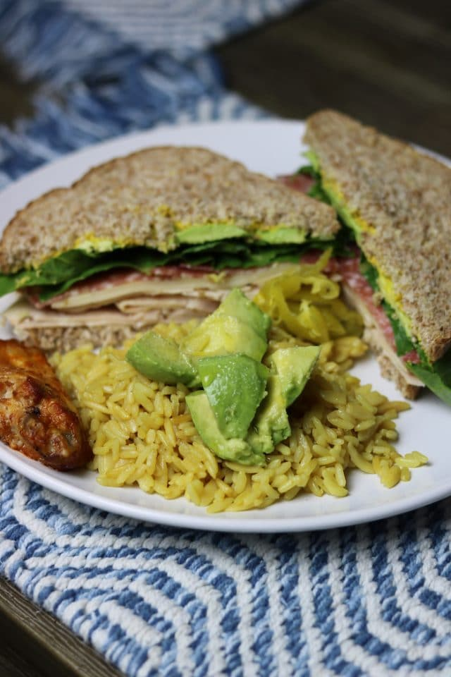 I made a sandwich with steamed deli chicken, salami, avocado, lettuce, mustard and mayo... plus a side of leftover rice pilaf with avo and one buffalo wing.