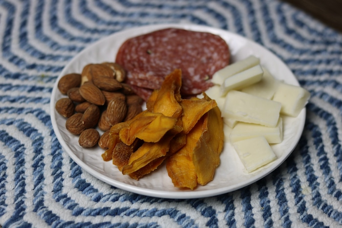 As a mid-day snack I made a small cheese plate (these are my favorite for snacks lately!). On my cheese plate: salami, goat cheddar cheese, 50% roasted salted almonds and dried mango).